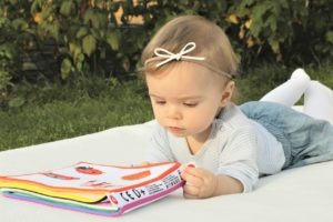 a baby and book
